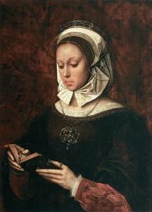 Una mujer joven leyendo un libro de horas