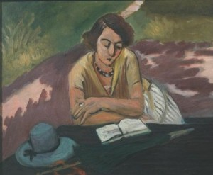Mujer leyendo con parasol