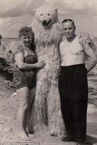 2AB69A0200000578-0-Day at the beach A middle aged couple stand next to polar bear w-m-44 1437472912897